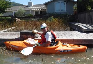 Judy and her catch on Coastal Cleanup Day 2016 on Gallinas Creek
