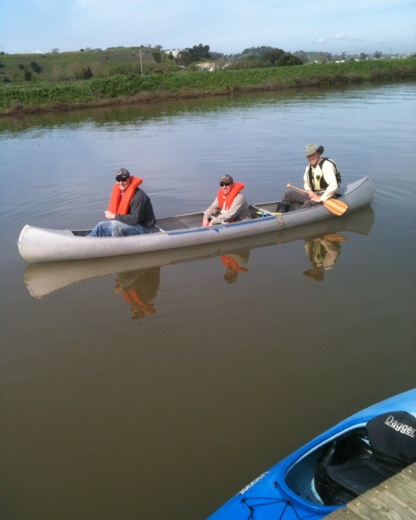 Damon Connolly, Marc Levine and Art Reichert on a canoe on Gallinas Creek. Photo by Robert Dobrin