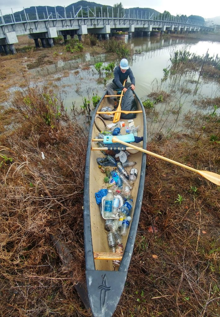 johnny in canoe during King Tide Creek Cleanup